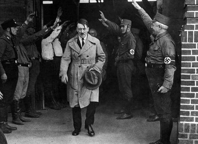 FILE - In this Dec. 5, 1931 file photo, Adolf Hitler, leader of the National Socialists, is saluted as he leaves the party's Munich headquarters. In Munich, Hitler launched his political career with speeches condemning Jews and proclaiming the ethnic superiority of Germans