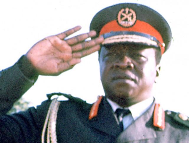 Ugandan dictator Idi Amin is shown saluting during an Organization of African Unity conference in Kampala, Uganda, in 1975.