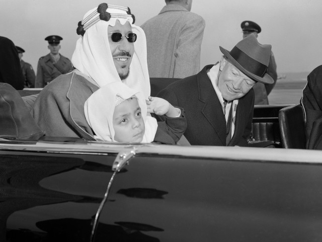 Six-year-old Prince Mashhur ibn Saud waves as he sits on the lap of his father, King Saud of Saudi Arabia, and beside President Eisenhower as they left National Airport, January 30, 1957.  The King and his official party will visit here three days for talks with the President.