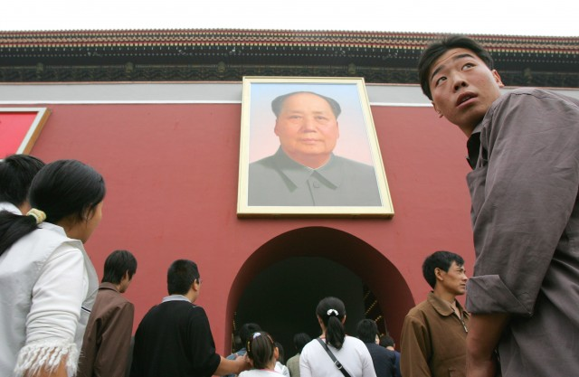 Visitors walk below the portrait of late communist leader Mao Zedong at Beijing's Tiananmen Gate on China's National Day, Saturday, Oct. 1, 2005. Thousands flocked to Tiananmen Square to celebrate the 56th anniversary of Mao's founding of communist China on October 1, 1949.
